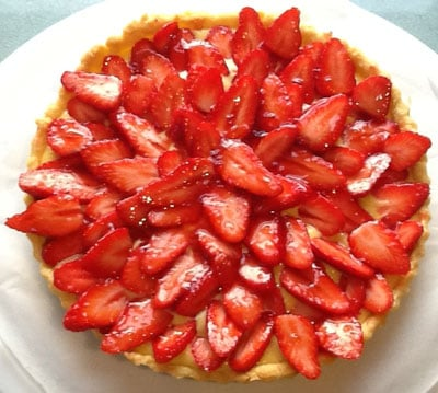 A classic Strawberry Tart recipe using summer's finest juiciest fruits with a creme patissiere & a strawberry glaze - delicious!