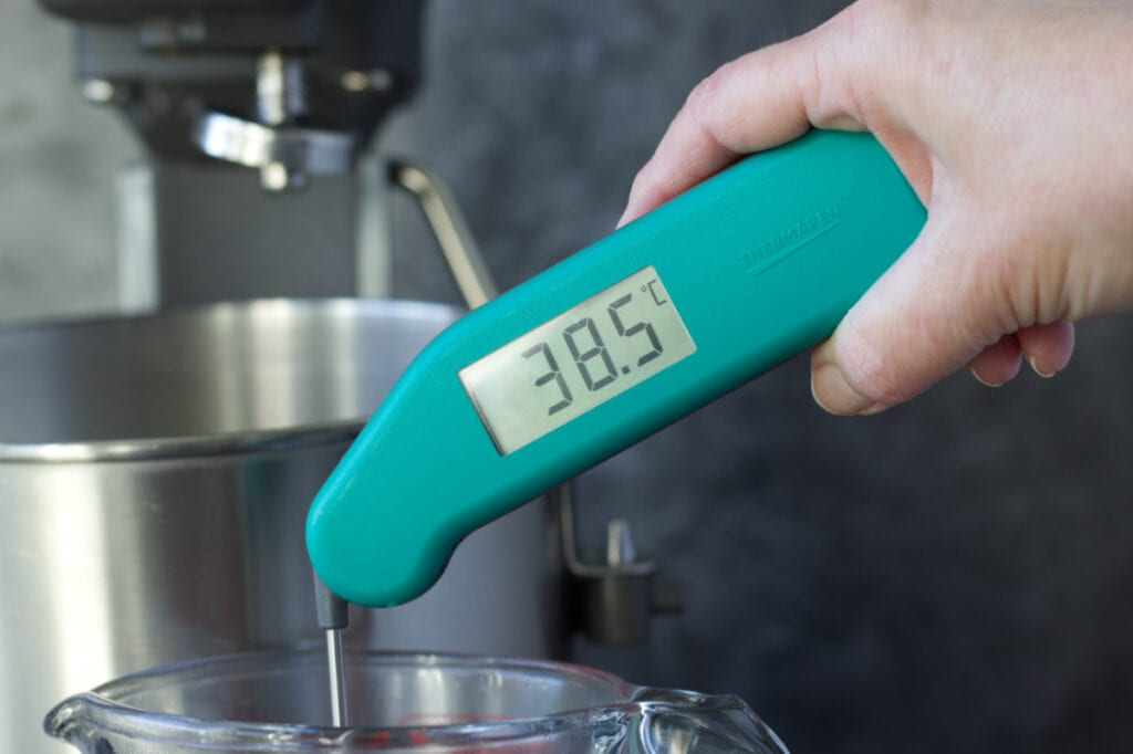 Thermapen being used to show the  temperature of the water at 38.5 centigrade.