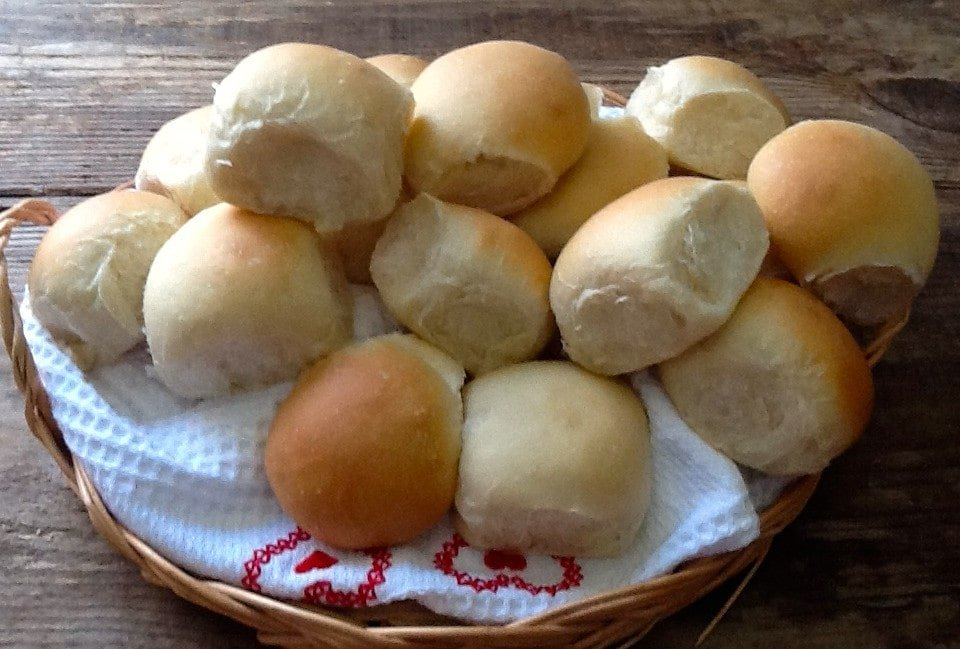 A basket of homemade mini bread rolls.