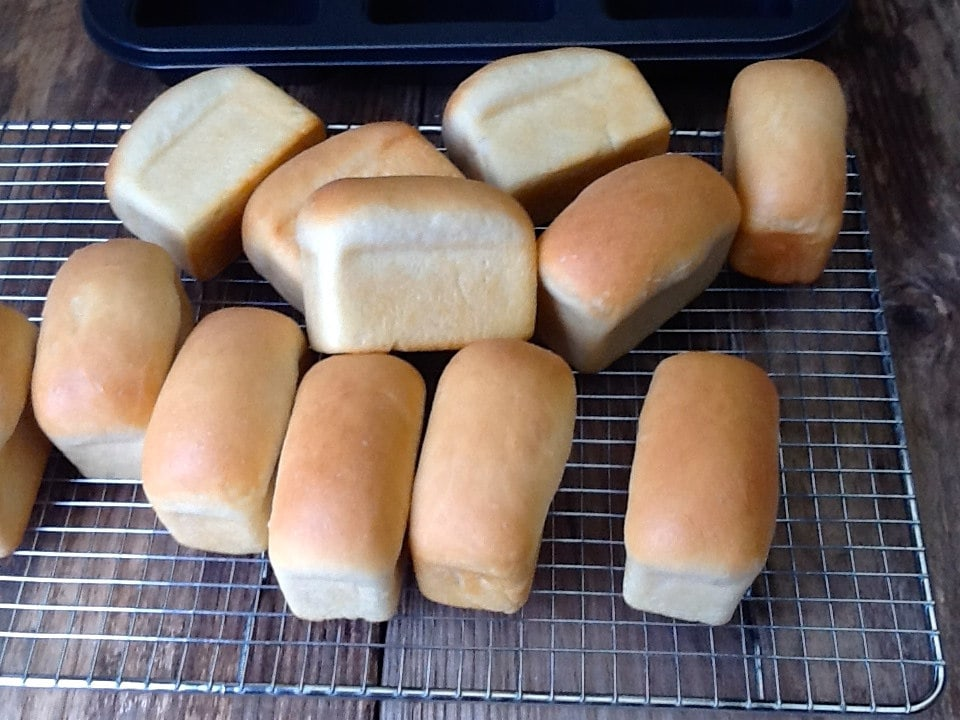 Mini loaves on a cooling rack.