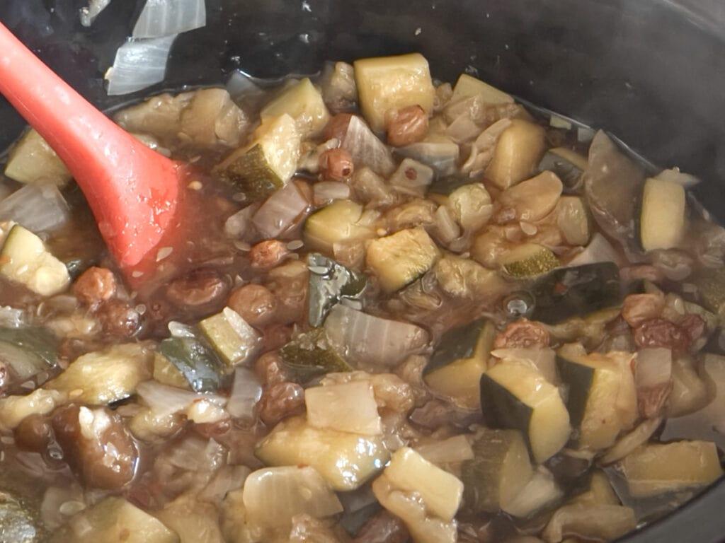 Fruit, vegetables, sugar and vinegar in a slow cooker.