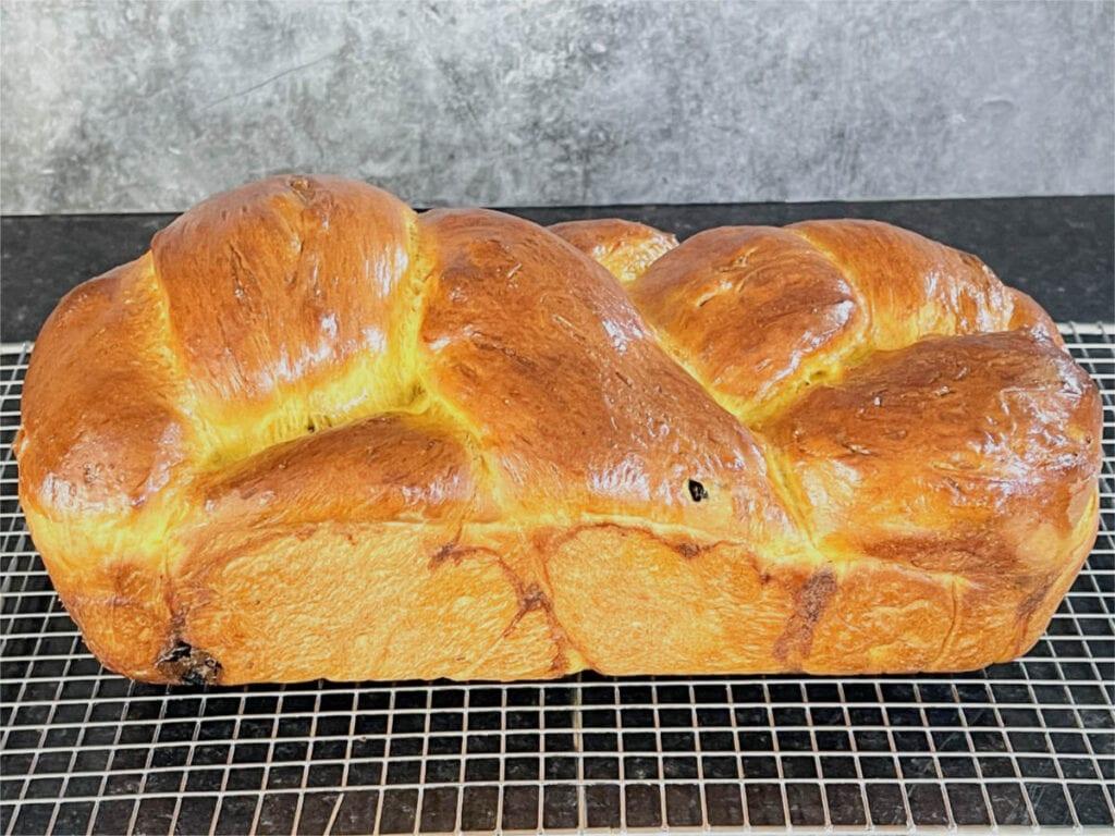 Freshly baked pumpkin loaf on a rack.