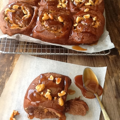 Seriously decadent Chocolate Peanut Butter Buns with caramelised peanuts and a drizzle of caramel sauce are for all you fellow peanut butter fans.