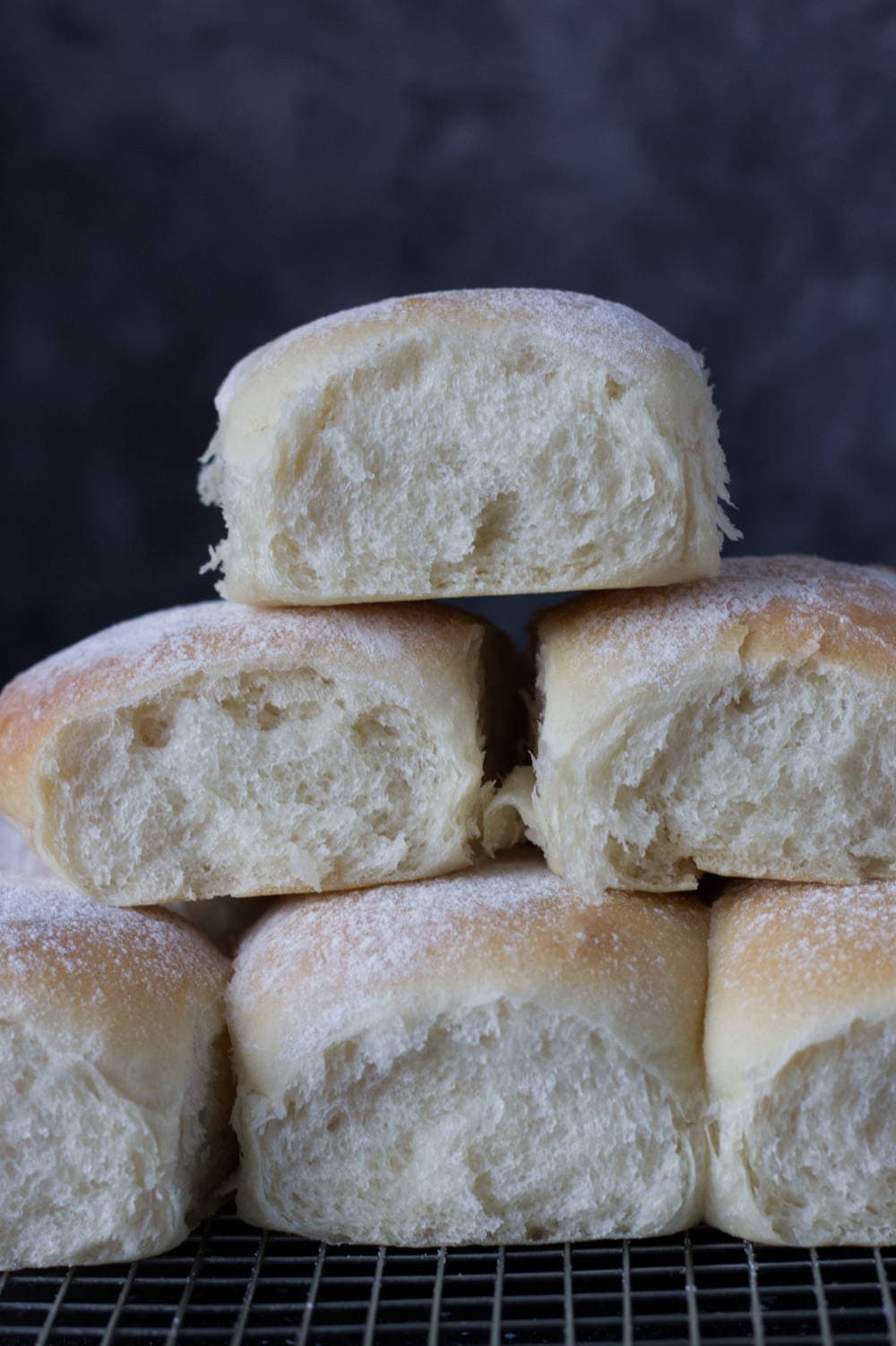 Pillowy Soft Bread Rolls with pull apart edges, guaranteed soft & fluffy every time. With easy step by step instructions!