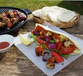 Homemade Chicken Kebabs. Freshly grilled marinated chicken, peppers and onions served in a pitta bread with salad & a hot chilli sauce. Healthy & delicious!