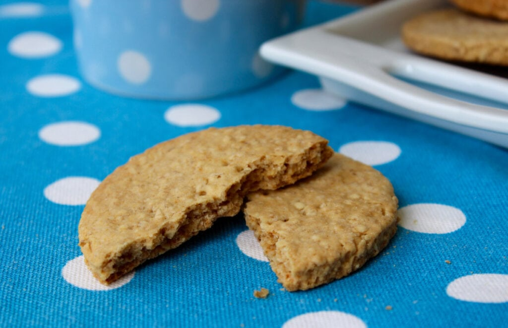 A close up of a broken oat cookie.