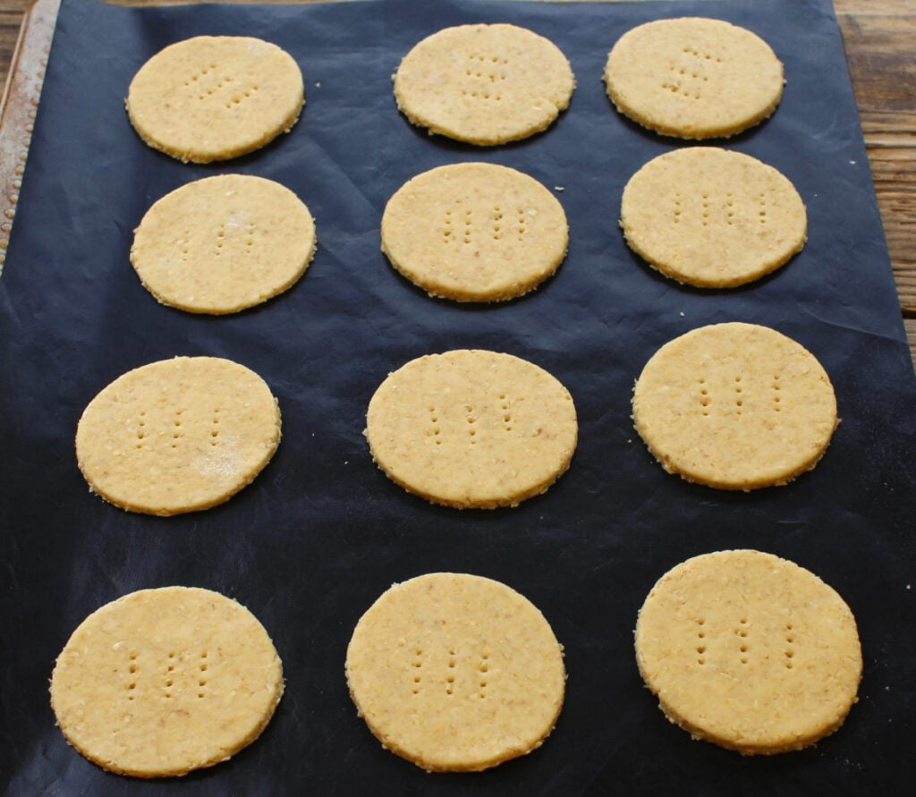 Healthy digestive biscuits on a tray ready for baking.