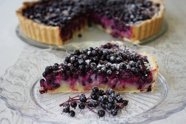 Elderberry Tart makes the most of this delicious foraged fruit. Elderberries & a cassis flavoured custard fill this butter pastry shell - my version of the much loved Tarte aux Myrtilles.