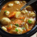 Slow Cooker Beef Stew & Dumplings - the perfect comfort food! A delicious beef stew loaded with vegetables cooked in your Crock Pot & topped with herb dumplings for a hearty one pot meal. A timeless classic you'll never tire of.