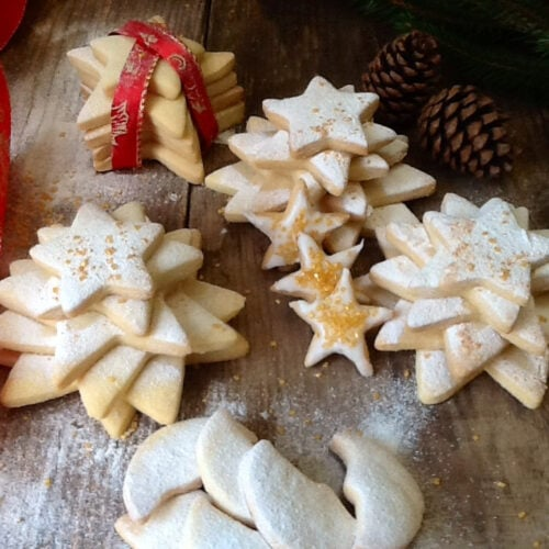 Christmas Shortbread Biscuits dredged with icing sugar and sparkles
