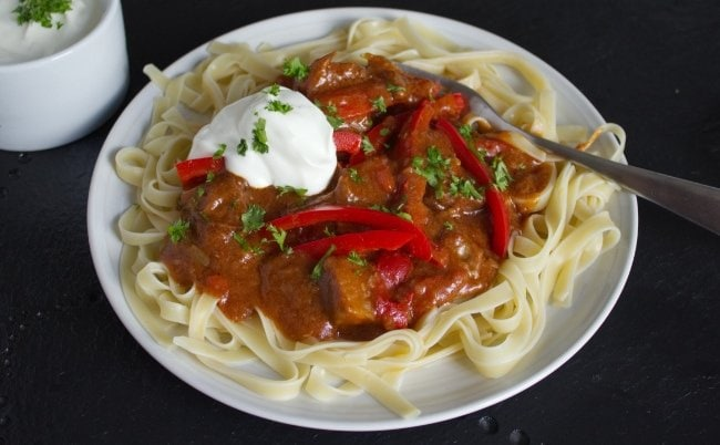 Slow Cooker Beef Brisket Goulash : Smoked paprika & plenty of peppers transform chunks of inexpensive lean brisket into something special. Serve with noodles & sour cream or a big bowl of creamy mashed potatoes.