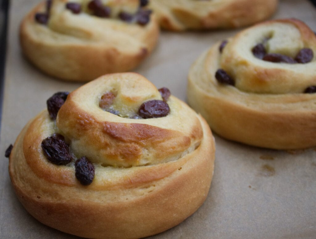 Freshly baked buns fresh from the oven without icing and cherry.