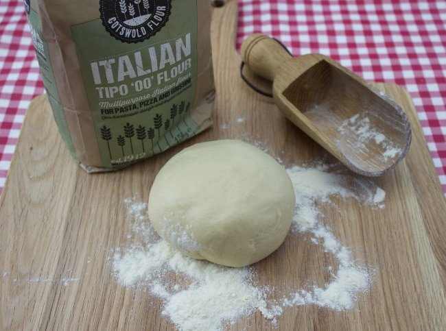 Homemade Pizza Dough is quick & easy to make. Add your favourite toppings and sauce for pizza perfection! Makes 2 x 10 inch thin crusts or 1 deep pan pizza crust. Even easier, spread with garlic butter & bake for delicious garlic bread.
