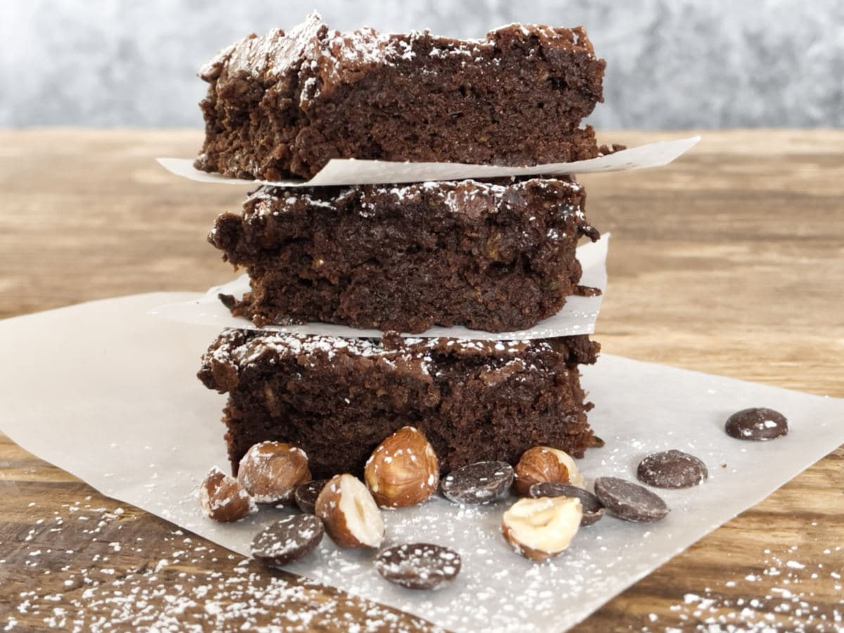 Three pieces of courgette brownie in a stack.