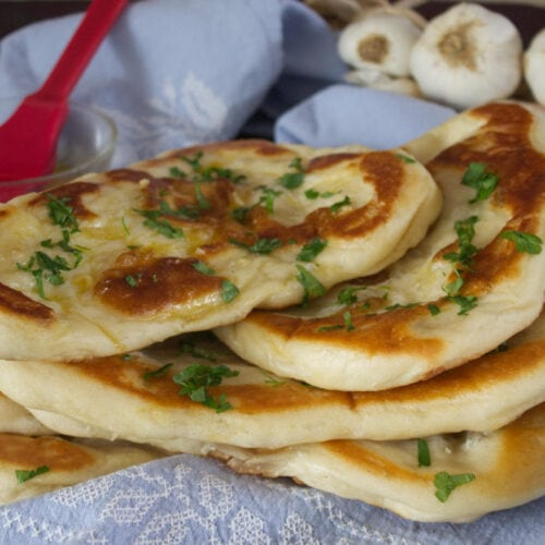 Homemade Garlic Naan Bread oozes with garlic butter and is deliciously soft with just the right amount of chew. Easy to make & so much better than shop bought !
