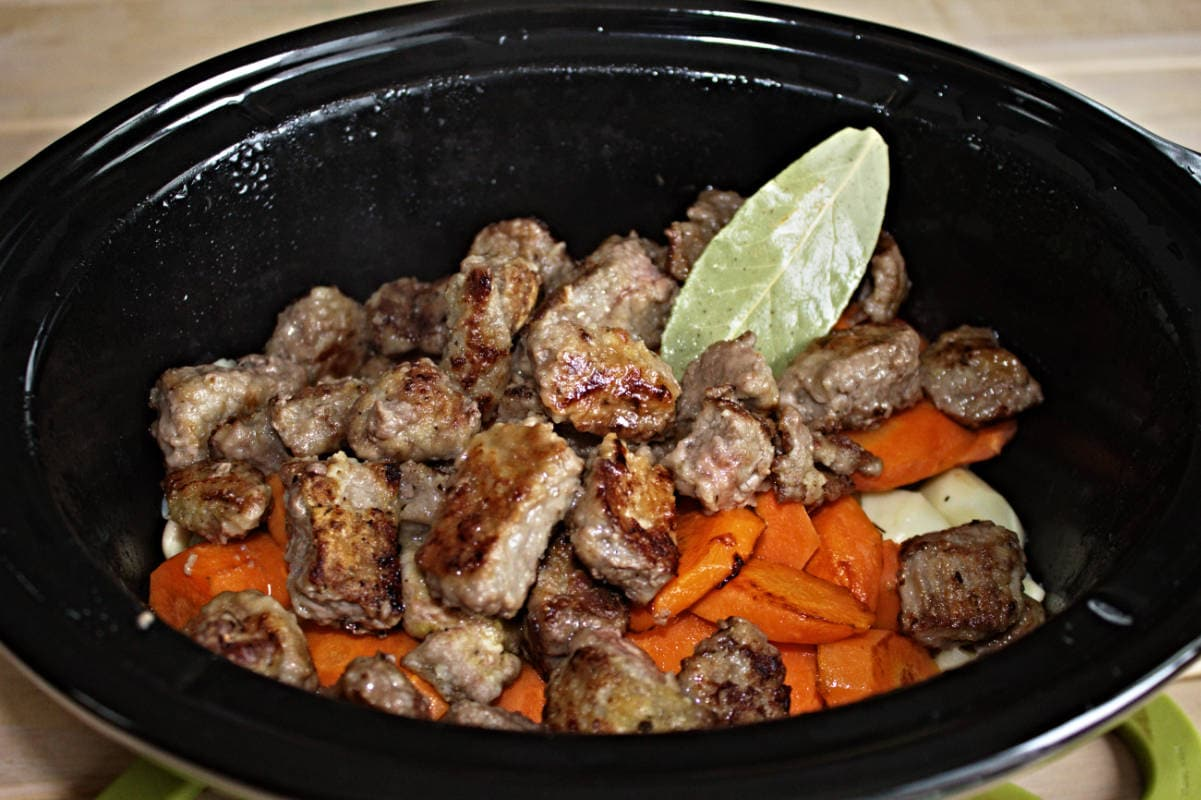 Browned beef, carrots and onions in the slow cooker.
