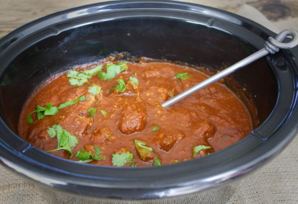 Beef Curry with fresh coriander ready to serve from the slow cooker.