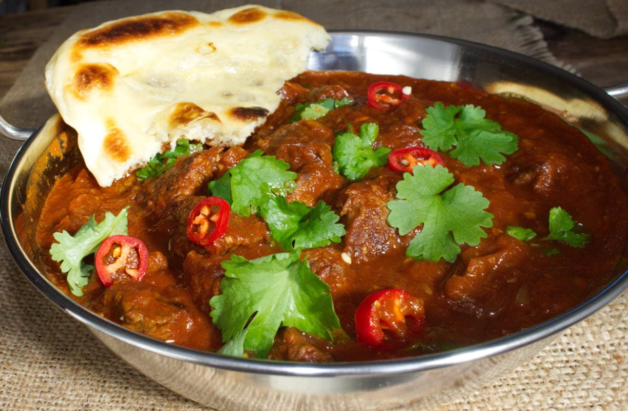 Beef Madras ready to eat served with Homemade Garlic Naan Bread.