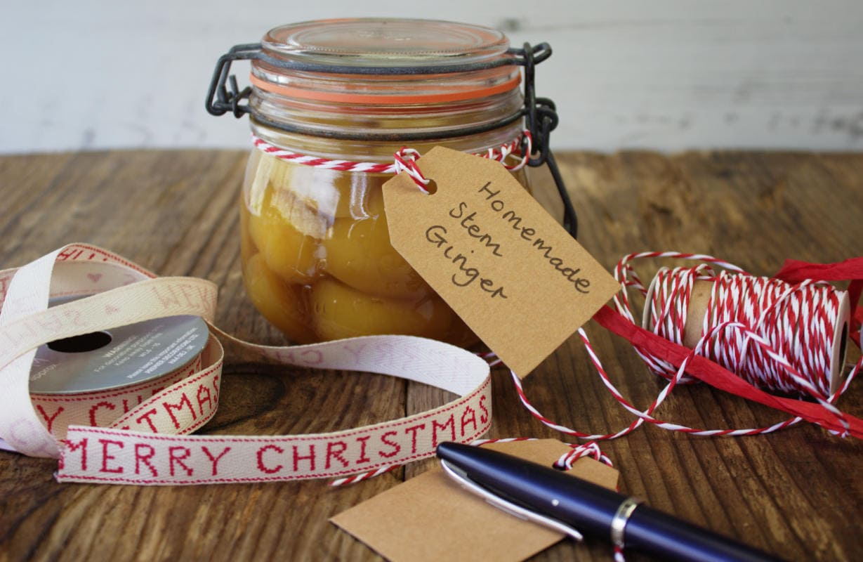 Stem ginger in a jar with Christmas labels.