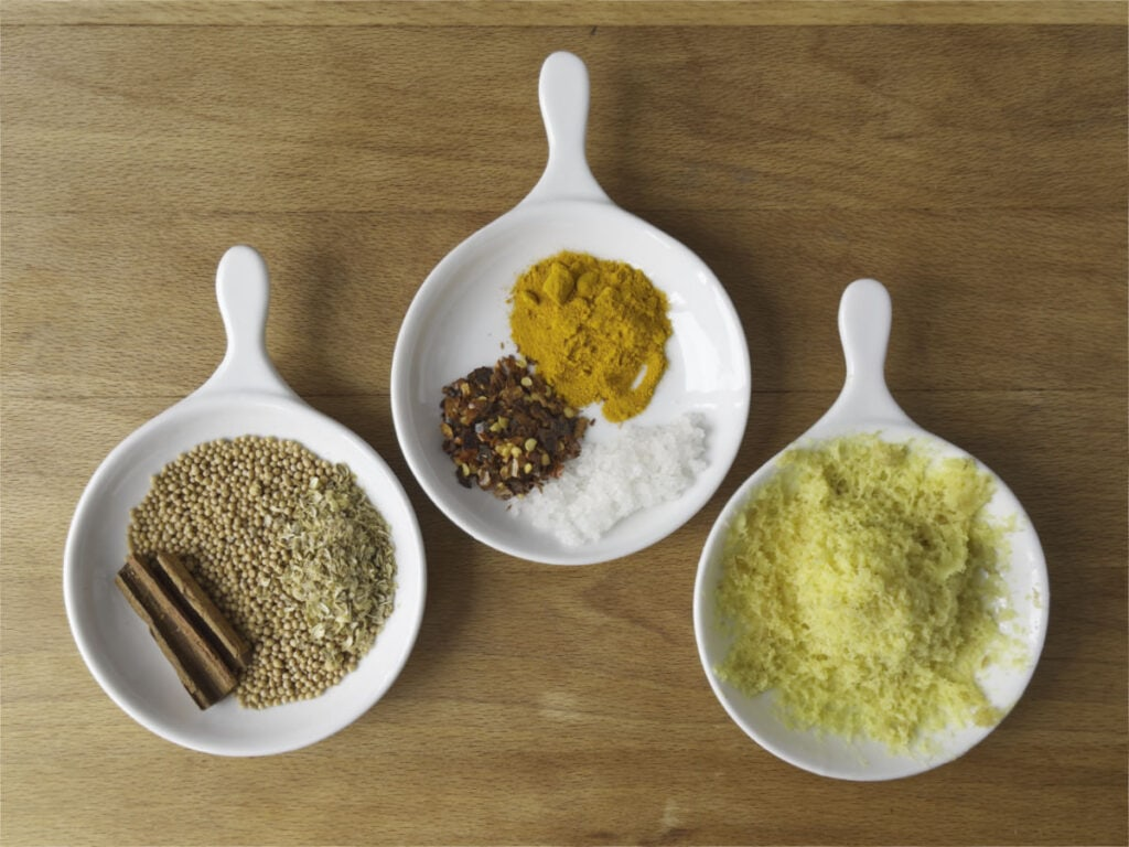Top shot of spices in dishes.
