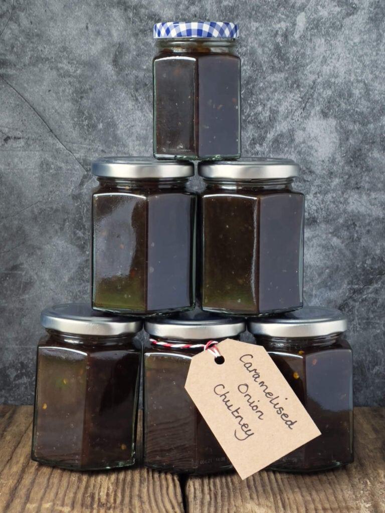 A stack of six jars of caramelised onion chutney.