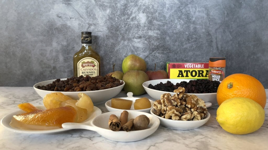 Bowls of dried fruit, citrus peel, walnuts, stem ginger, spices with fruit, suet and Calvados.